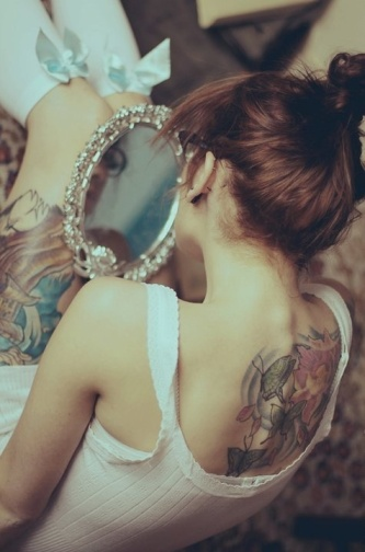 Girl with a Back Tattoo